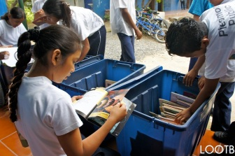 The Mobile Library lending books to schools, the kids love it!