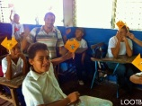 Jonathon teaching arts & crafts to kids of the schools that the Mobile Library Project went to!