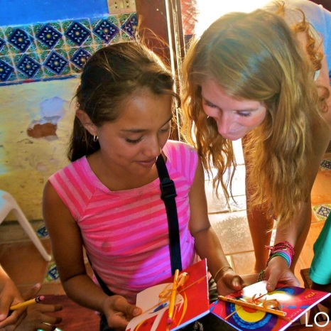 Quinn giving out notebooks at the Barrio Planta Project in San Juan del Sur