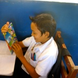 A smart and very sweet guy admiring his new LOOTB notebook in class at Escuela Las Marias in southern Nicaragua