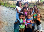 A big group of neighborhood kids happy with their LOOTB notebooks!