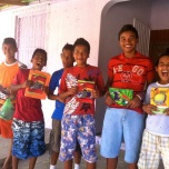 A great group of young boys with their new notebooks in the rural area of San Juan del Sur